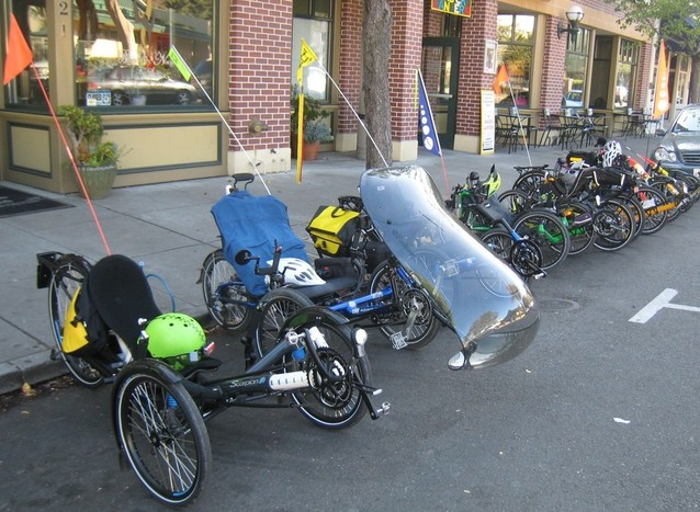 [photo: group of parked recumbent tricycles]